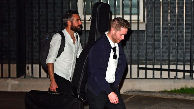 People carrying musical instruments leave 10 Downing Street on Saturday