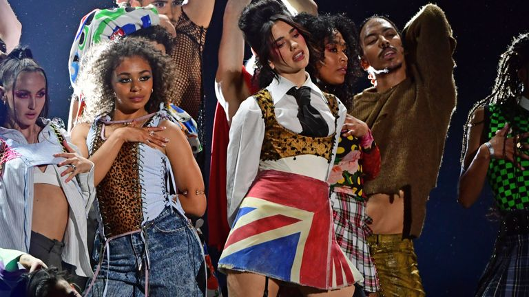 Dua Lipa (centre right) performs during the Brit Awards 2021 at the O2 Arena, London