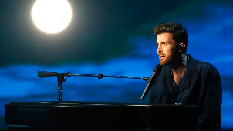 """Duncan Laurence of the Netherlands performs the song """"Arcade"""" during the 2019 Eurovision Song Contest grand final in Tel Aviv, Israel, Saturday, May 18, 2019. (AP Photo/Sebastian Scheiner)"""