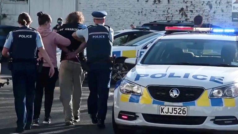 Police officers detain a man after a stabbing incident at the Countdown supermarket, in Dunedin, New Zealand, May 10, 2021 in this screen grab taken from video. Pic: Otago Daily Times