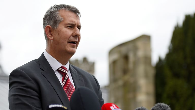 Democratic Unionist Party's (DUP) Edwin Poots makes a statement to the media outside Stormont Castle in Belfast