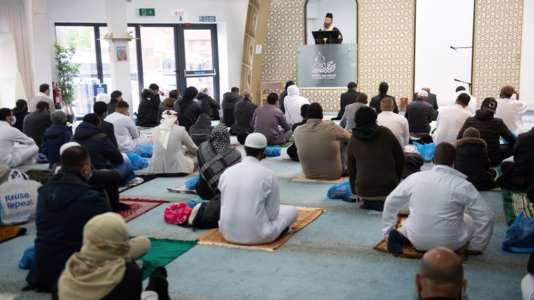 Worshippers at Green Lane Mosque in Birmingham take part in a prayer sitting to celebrate Eid al-Fitr