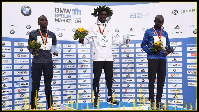 Eliud Kipchoge, centre, set a record time when he won the Berlin marathon in 2018