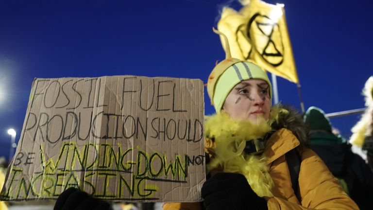 An Extinction Rebellion member protests the expansion of Bradley open-cast coal mine in County Durham