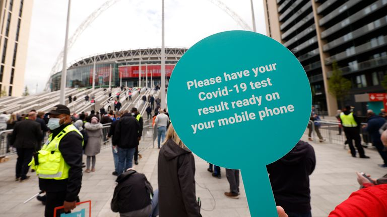 Soccer Football - FA Cup Final - Chelsea v Leicester City - Wembley Stadium, London, Britain - May 15, 2021 General view of a sign in reference to Covid-19 test results seen outside the stadium before the match, as 21,000 fans will be in attendance because the FA Cup final is part of the UK government test events Action Images via Reuters/John Sibley