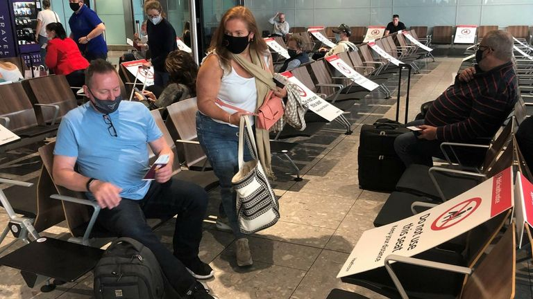 Passengers at Heathrow Airport waiting to board a flight to Faro in Portugal