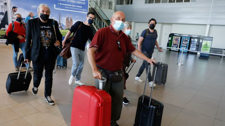 People arrive at Faro Airport from Manchester on the first day that Britons are allowed to enter Portugal without needing to quarantine, as coronavirus restrictions continue to be eased