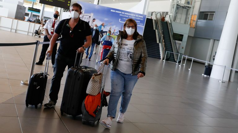 People arrive at Faro Airport from Manchester