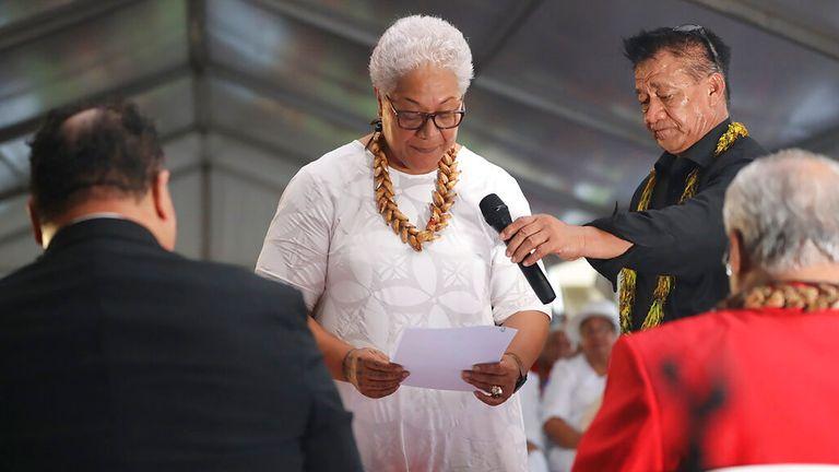 Fiame Naomi Mata'afa takes her oath inside a tent outside parliament