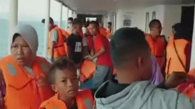 Indonesia ferry catches fire, passengers jump to sea