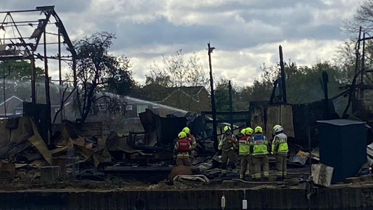 Firefighters have been damping down after putting out the flames