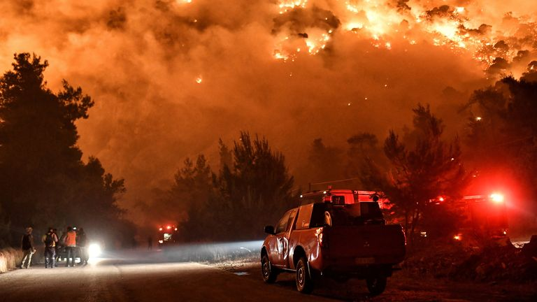 Smoke was seen in from Athens as the fire brigade battled the blaze for a third day