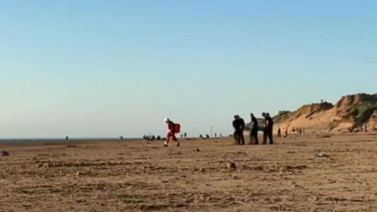 Three men were airlifted to hospital after an axe and samurai sword attack on Formby beach