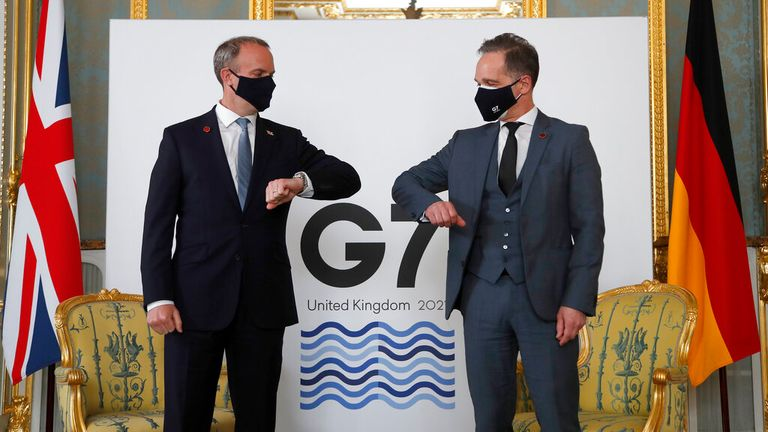 Dominic Raab touches elbows with German counterpart Heiko Maas. Pic: AP