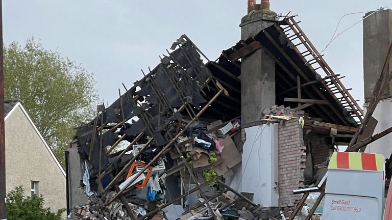 Two houses were destroyed and one collapsed, police said.
