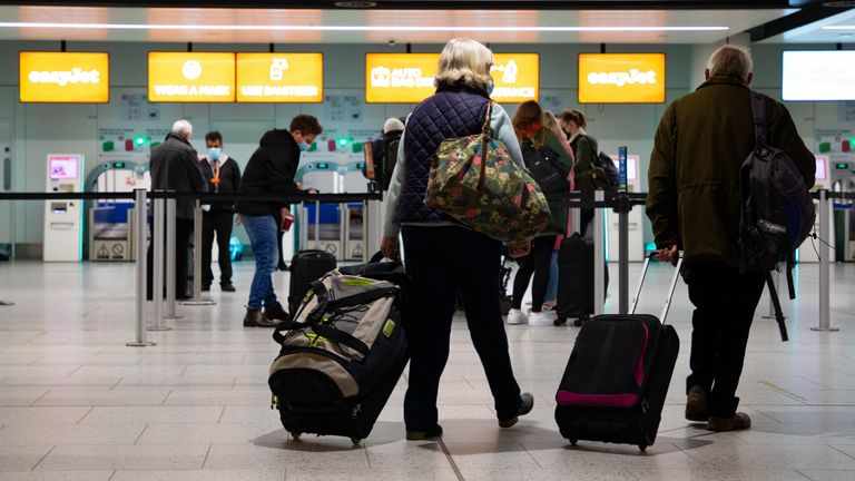 EDITORIAL USE ONLY Passengers check in for the first holiday and leisure flight to take-off at Gatwick Airport