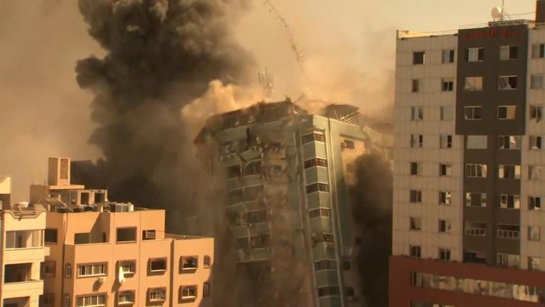 The media building starts to collapse after being hit by an Israeli bombardment