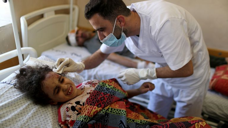 Palestinian girl Suzy Eshkuntana, 6, was pulled from rubble in Gaza City