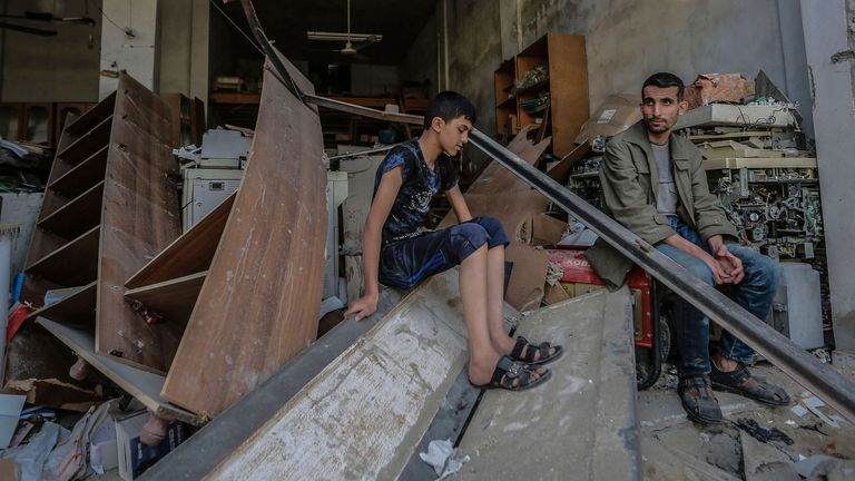 Palestinians inspect the remains of a destroyed building in Jabalia after it was hit during Israeli airstrikes. Pic: AP