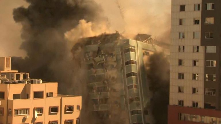Media building collapses in Gaza City after being bombed by Israeli forces