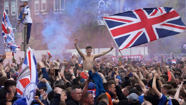 Rangers fans outside the ground during the Premier League match at Ibrox Stadium, Glasgow. Picture date: Saturday May 15, 2021.