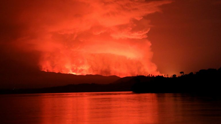 Smoke and flames are seen at the Nyiragongo volcanic eruption from the Tchegera Island on Lake Kivu, near Goma, in the Democratic Republic of Congo May 22, 2021. Picture taken May 22, 2021. REUTERS/Alex Miles