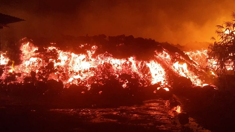 Flowing lava from the volcanic eruption of Mount Nyiragongo, which occurred late on May 22, 2021, is seen in Goma, Democratic Republic of Congo, in this still image from undated video obtained via social media. ENOCH DAVID via REUTERS