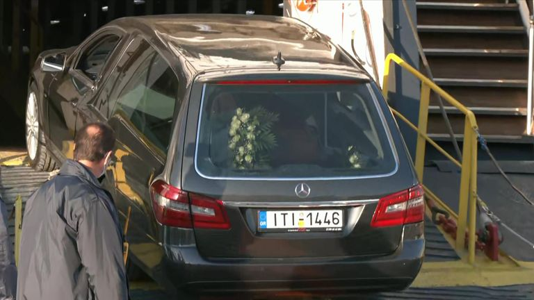 The hearse is pictured arriving at the funeral