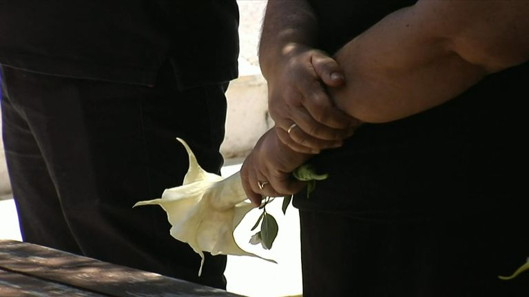 A flower was placed on Ms Crouch's coffin