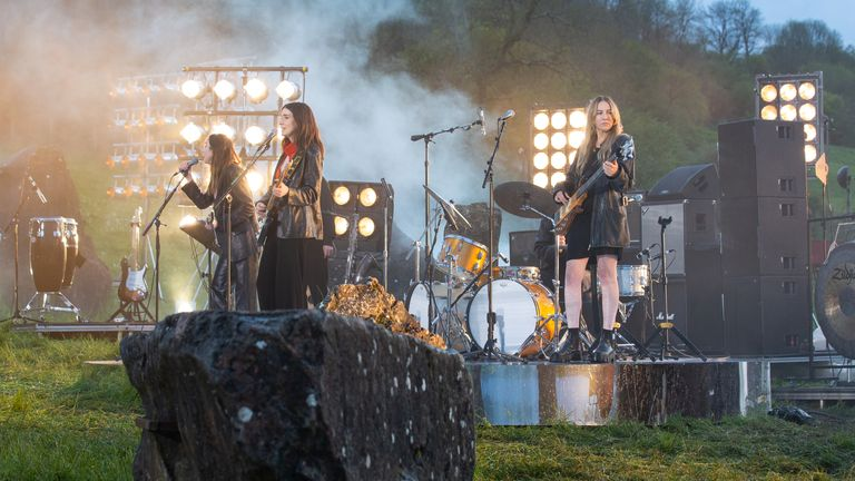 Undated handout photo issued by Glastonbury presents Live at Worthy Farm of Haim performing for the livestreamed event at Worthy Farm. Issue date: Saturday May 22, 2021.