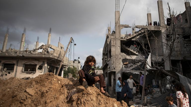 Palestinians inspect their destroyed homes, as they returned following a ceasefire reached after an 11-day war between Gaza's Hamas rulers and Israel. Pic: AP