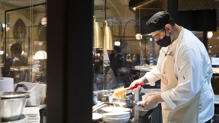 Chef Alberto Gargiulo prepares food for customers at new restaurant Pasta Evangelists