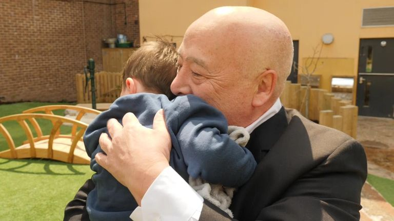 Moment two-year-old Rhu hugs his 76-year-old grandad Tony Chin in Liverpool on the day hugs are allowed.