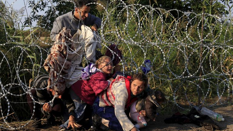 Mr Orban's government put up razor wire on the Hungarian border in 2015 to try to prevent migrants, like these from Syria, from entering