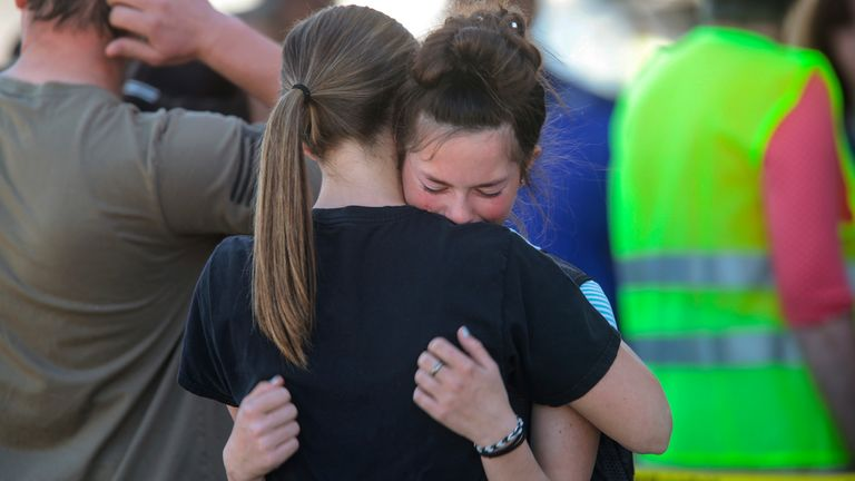 Students embrace after a school shooting at Rigby Middle School in Rigby, Idaho on Thursday, May 6, 2021. Authorities say a shooting at the eastern Idaho middle school has injured two students and a custodian, and a male student has been taken into custody.  (John Roark /The Idaho Post-Register via AP)