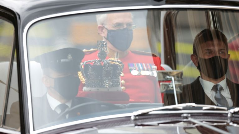 The Imperial State Crown is taken from Buckingham Palace to the Palace of Westminster in London for the State Opening. Picture date: Tuesday May 11, 2021.