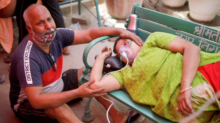 A woman receives oxygen support for free outside a Sikh temple in Ghaziabad, Uttar Pradesh, India