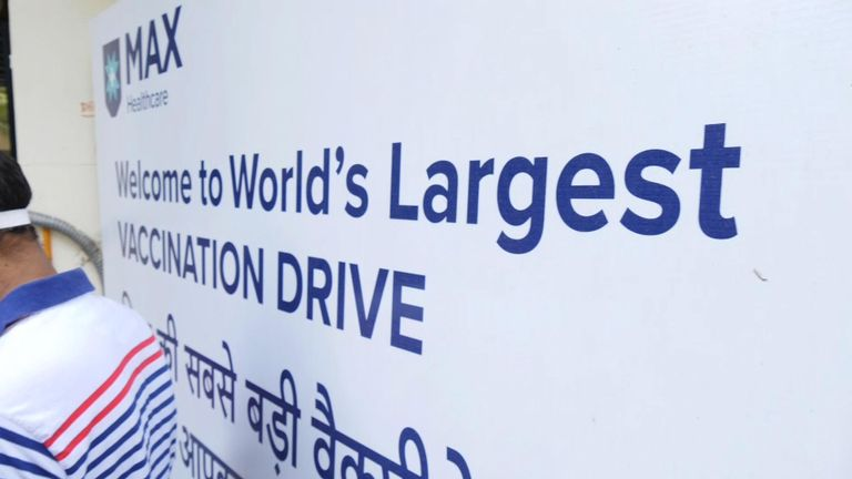 A sign advertising what India says it the world's largest vaccination drive