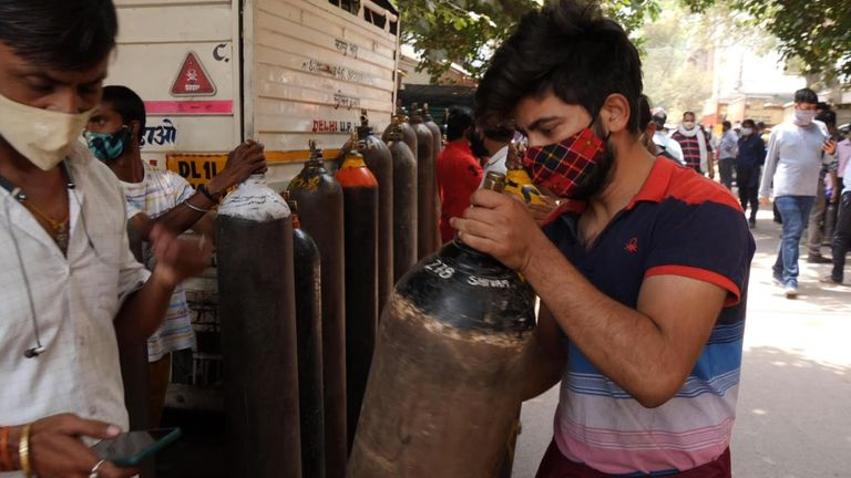 People queue to get fresh supplies of oxygen in India