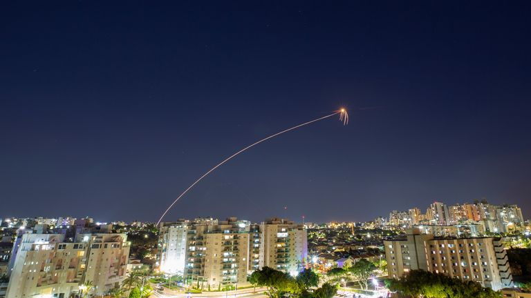 Streaks of light are seen as Israel's Iron Dome anti-missile system intercepts rockets launched from the Gaza Strip towards Israel, as seen from Ashkelon, Israel May 14, 2021. REUTERS/Amir Cohen