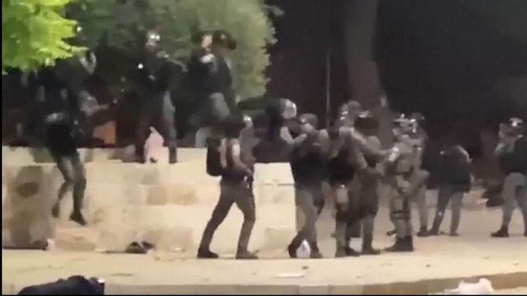 Israeli police shot tear gas and stun grenades towards rock-hurling Palestinian youths at Jerusalem's Al-Aqsa Mosque.