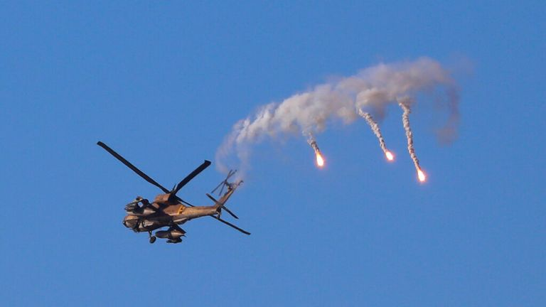Israeli helicopter launches flares over the Israeli-Gaza border. Pic:AP