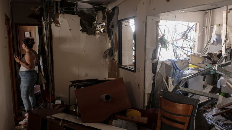 A woman walks inside her parents' apartment after it was hit with a rocket fired from Gaza, in Ashdod, Israel May 17, 2021. REUTERS/Ronen Zvulun