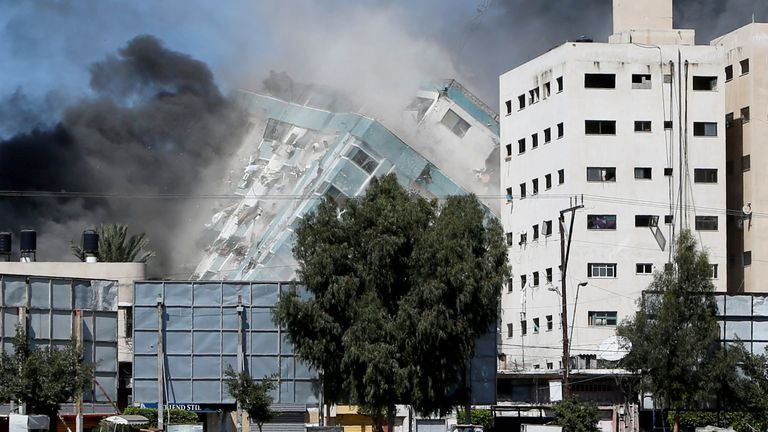 A tower housing AP, Al Jazeera offices collapses after Israeli missile strikes in Gaza city,