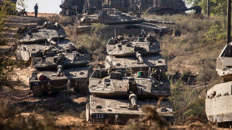 Israeli army tanks seen positioned on the Israeli-Gaza border near Sderot. Pic: AP