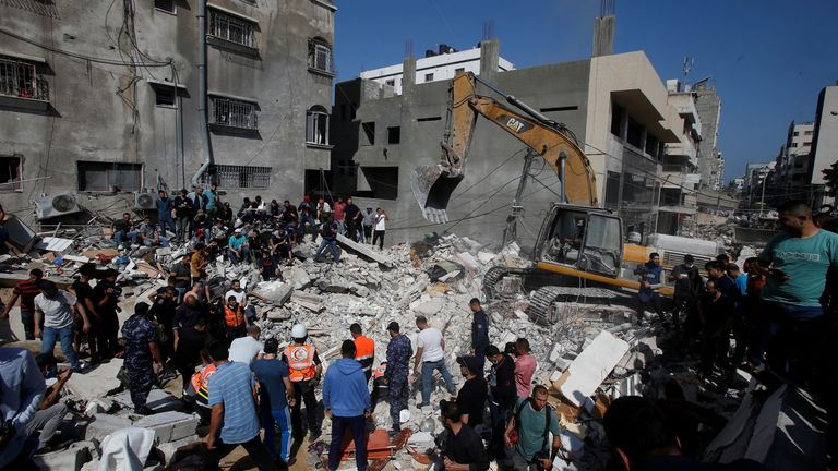 Rescue workers search for victims in Gaza City