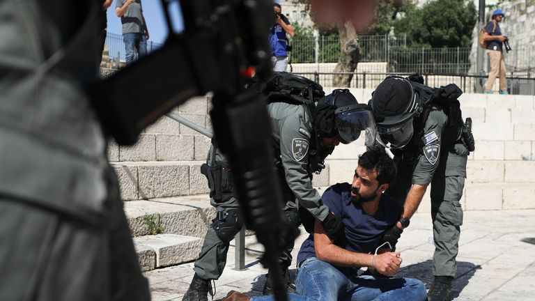 Security forces detain a protestor during a demonstration held to show solidarity amid Israel-Gaza fighting