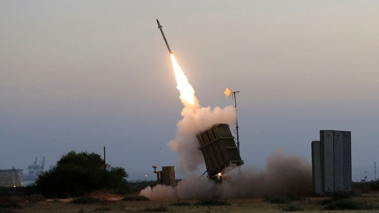 In this July 5, 2014 file photo, an Iron Dome air defense system fires to intercept a rocket from Gaza Strip in the costal city of Ashkelon, Israel. The Israeli Defense Ministry said Tuesday, March 16, 2021 that the Iron Dome air defense system has been upgraded and is now capable for intercepting rocket and missile salvos as well as simultaneous attacks by unmanned aerial vehicles. (AP Photo/Tsafrir Abayov, File)