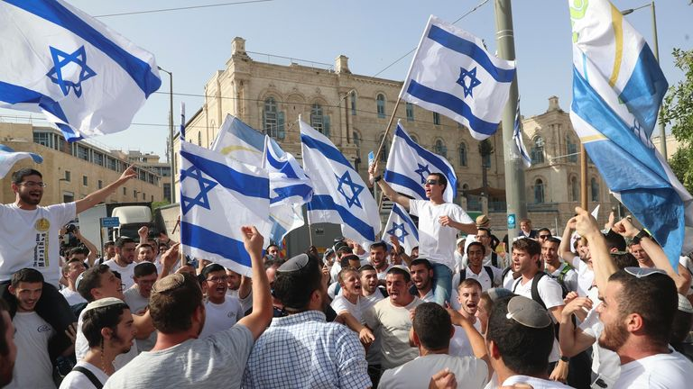 Israelis wave national flags during a Jerusalem Day march, in Jerusalem. Pic: AP