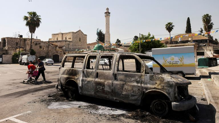 A burnt vehicle is seen after violent confrontations in the city of Lod, Israel between Israeli Arab demonstrators and police, amid high tensions over hostilities between Israel and Gaza militants and tensions in Jerusalem May 12, 2021